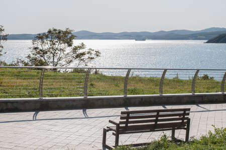 Peaceful place with bench and seascape scenery Stockfoto