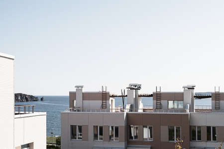 Modern minimalistic apartment building with sea view