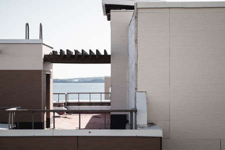 Old roof of minimalistic apartment building with sea view