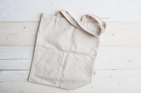 Cotton fabric organic bag mockup on white wooden background