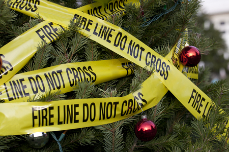 A Christmas tree is covered with fire tape to illustrate the danger of fire during the Christmas season.