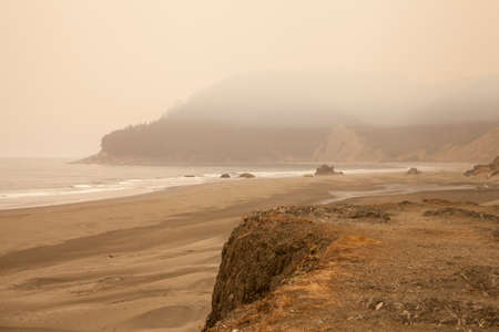 The yellow cast and heavy haze of the beach in Oregon were caused by smoke from wildfires in 2017.