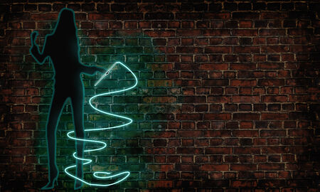 whip: girl with neon whip against a brick wall