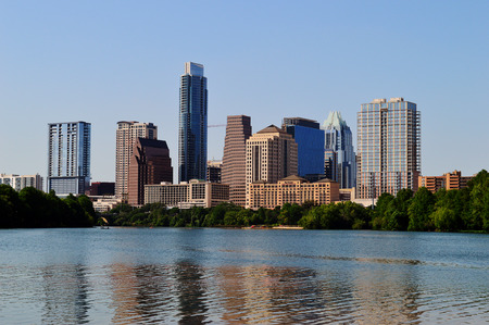 Austin Skyline in Austin Texas from the riverbank Stock Photo