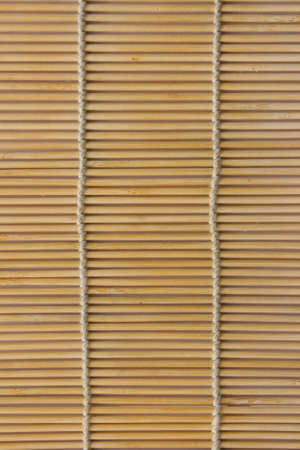 bamboo mat light-colored piece of string tied ecological