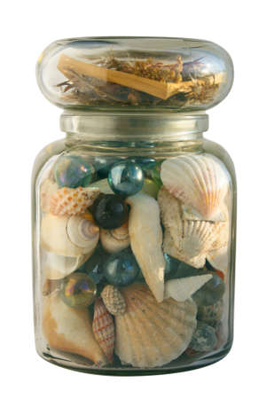 glass jar with shells brought in from the sea Stock Photo