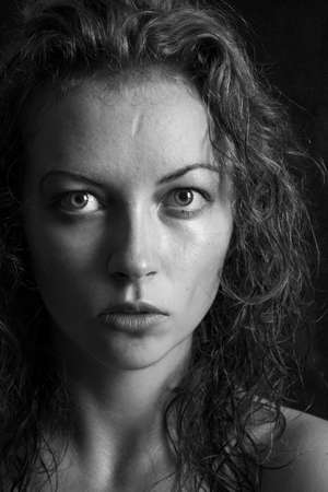black and white portrait of a girl a woman with big eyes and curly hair Stock Photo