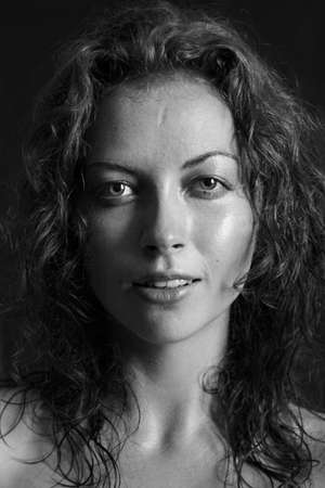 black and white portrait of a girl a woman leer and curly hair photo