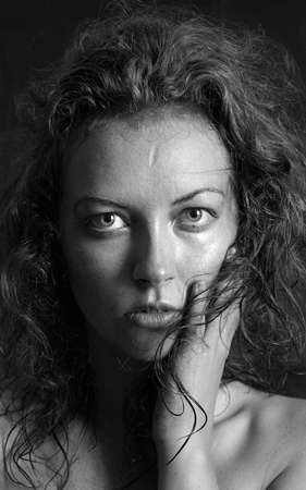 black and white portrait of a girl a woman with big eyes and curly hair Stock Photo - 12888870