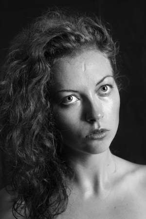 black and white portrait of a girl a woman with big eyes and curly hair Stock Photo - 12888810