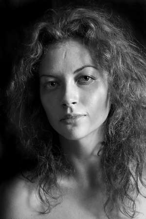 black and white portrait of a girl a woman with big eyes and curly hair Stock Photo - 12888869