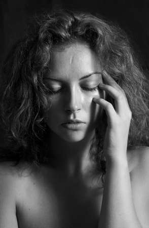 black and white portrait of a girl a woman with close eyes and curly hair