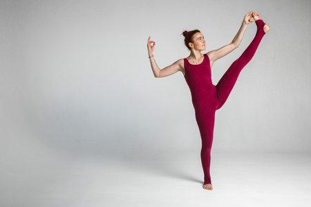 beautiful athletic girl shows yoga poses Archivio Fotografico