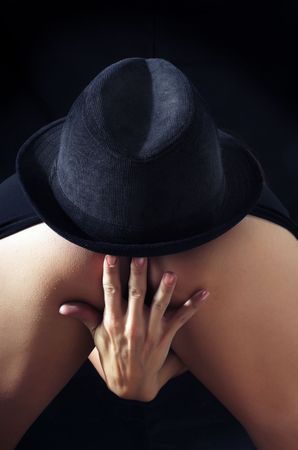 fanny: Close-up photo of the woman back with black hat Stock Photo