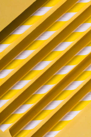 yellow parallel logs on the floor, unusual design concept. pattern with candy parallel lines