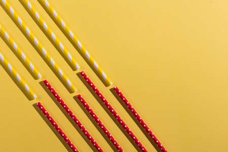 red and yellow straws isolated on the yellow background, copy space. 版權商用圖片