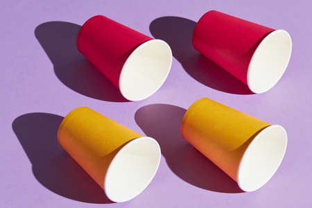 side view photo, four red and yellow cups, isolated on the blue background,business, interesting game for children