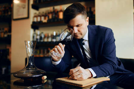 young professional sommelier performing a test on the taste, appeal of wine . close up photo Stockfoto