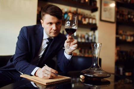 wine expert working in the restaurant. creation of wine list.