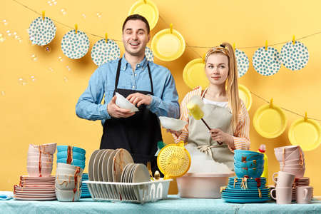 gorgeous couple performing hand washing in the kitchen room. close up photo. Фото со стока