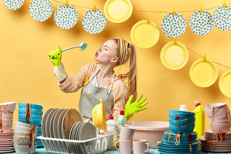 funny housekeeper enjoying time in the kitchen. close up side view photo.close up side view photo.happiness, housekeeping concept