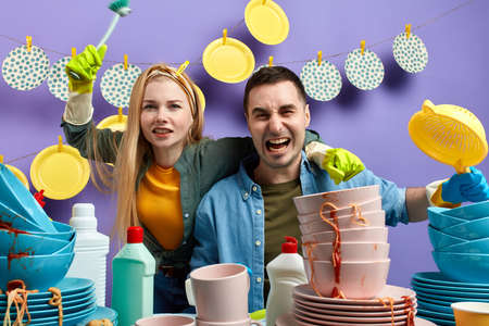 crazy emotional young couple having fun in the kitchen. close up photo. happiness and entertainment concept. Фото со стока