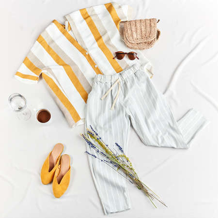 Female holiday clothes and accessories, flat lay, top view.fashion and design. summer outfit for holidaymakers Stock Photo