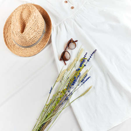 linen white dress from natural material. trade, online shopping . top view cropped photo