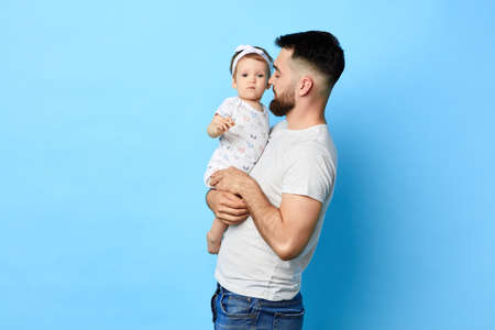 happy father and his daughter posing to the camera. close up photo. isolated blue background. studio shot.copy space Stock Photo
