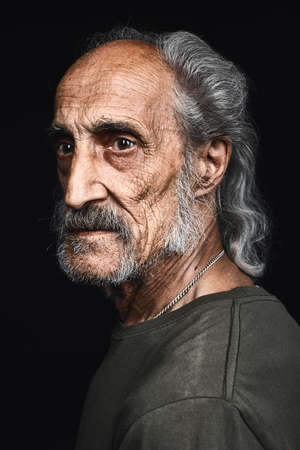 profile of senior man with gray hair and bold with serious expression. close up side view portrait.philosopy of life. senility concept. decline Фото со стока