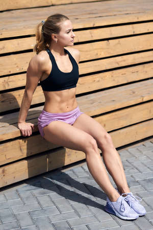 slim muscular girl crunching the abdominals, full length photo.leisure time concept.