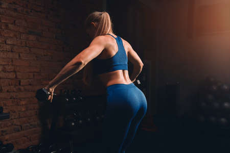 girl developing, flexing back muscles. close up back view photo. copy space.