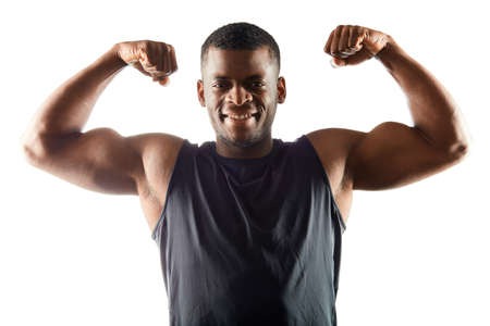 cheerful positive afro sportsman showing his perfect body after training. close up portrait. isolated white background. lifestyle, wellness, wellbeing, body and health care. Stock Photo