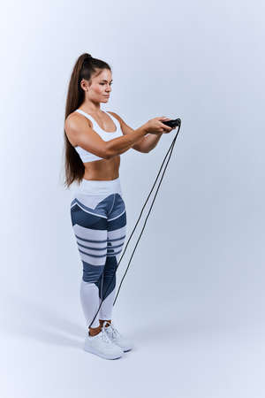 young beautiful motivated woman doing sport at gym, isolated white background, lifestyle, health and body care