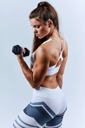 motivated pleasant woman concentrated on training, back view photo. motivation.isolated white background