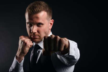 successful clever businessman resist opponent. man ssolving problems. close up portrait, isolated black background, studio shot 写真素材