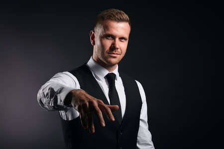 funny office worker giving hand for an handshake to seal the agreement isolated on black background, busisness,man is dancing, singing a rep. close up portrait, Stock Photo