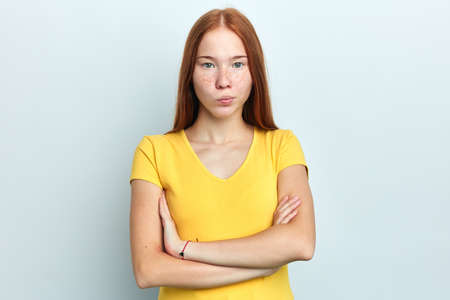 Closeup portrait displeased annoyed angry frustrated woman with bad attitude, arms crossed looking at camera , isolated white background. Negative human emotion facial expression feeling Фото со стока
