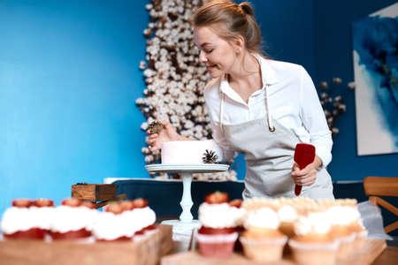 ideas for new year cake, girl making her cake look beautful