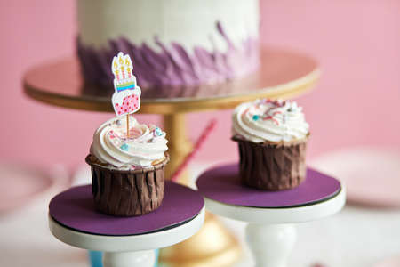 delicious cupcakes for birthday party, yummy dessert for children. close up cropped photo. food concept