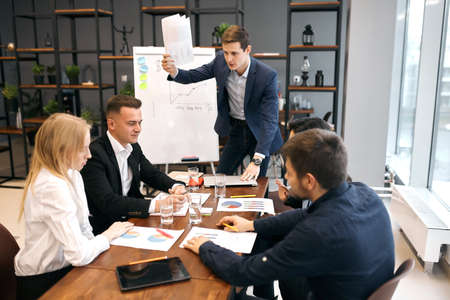 business people sum up the results of their work in the company during the year, close up photo office workers developing new project indoors, lifestyle, job, profession