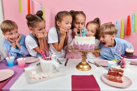 little children being afraid of breaking any detail of cake. close up photo. Stok Fotoğraf