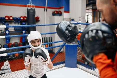 young begginer of boxing wants to get more fit for sport, training routine for young boxers. close up photo