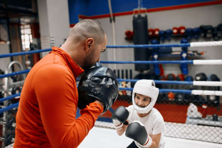 combat instructor training with a kid. close up photo. effective training program for children