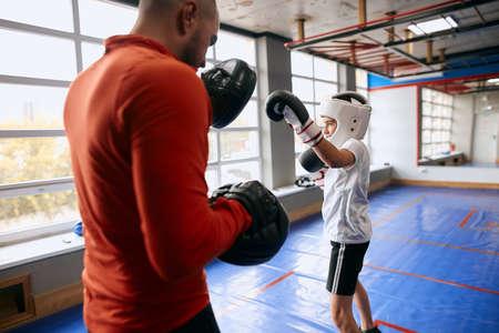 positive kid learning to defend himself, close up photo. Zdjęcie Seryjne