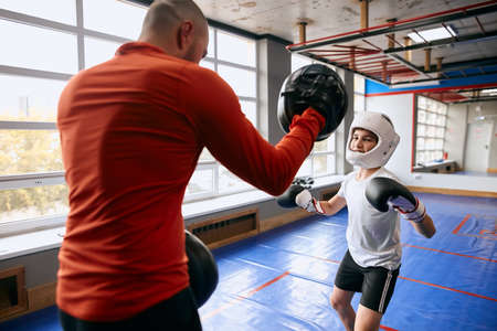 physical fitness for children, boy practising martial art. close up photo Reklamní fotografie
