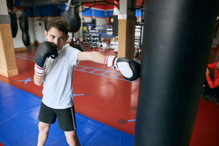 little boy is keen on kickboxing, kid loves sport, healthy, active lifestyle