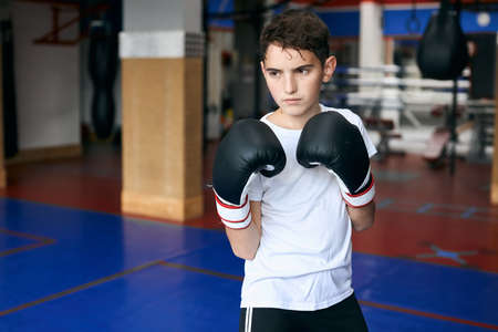 serious confident sweaty tired boy standing in boxing position. close up photo. hobby, interest . lifestyle Zdjęcie Seryjne