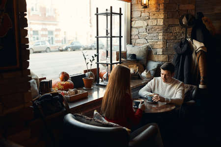 young family having breakfast in the cafe, copy space, love, relationship, affection,man and woman solving problems