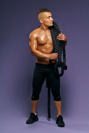 personal trainer looking for students for fitness workout. full length photo. isolated blue background, studio shot 版權商用圖片